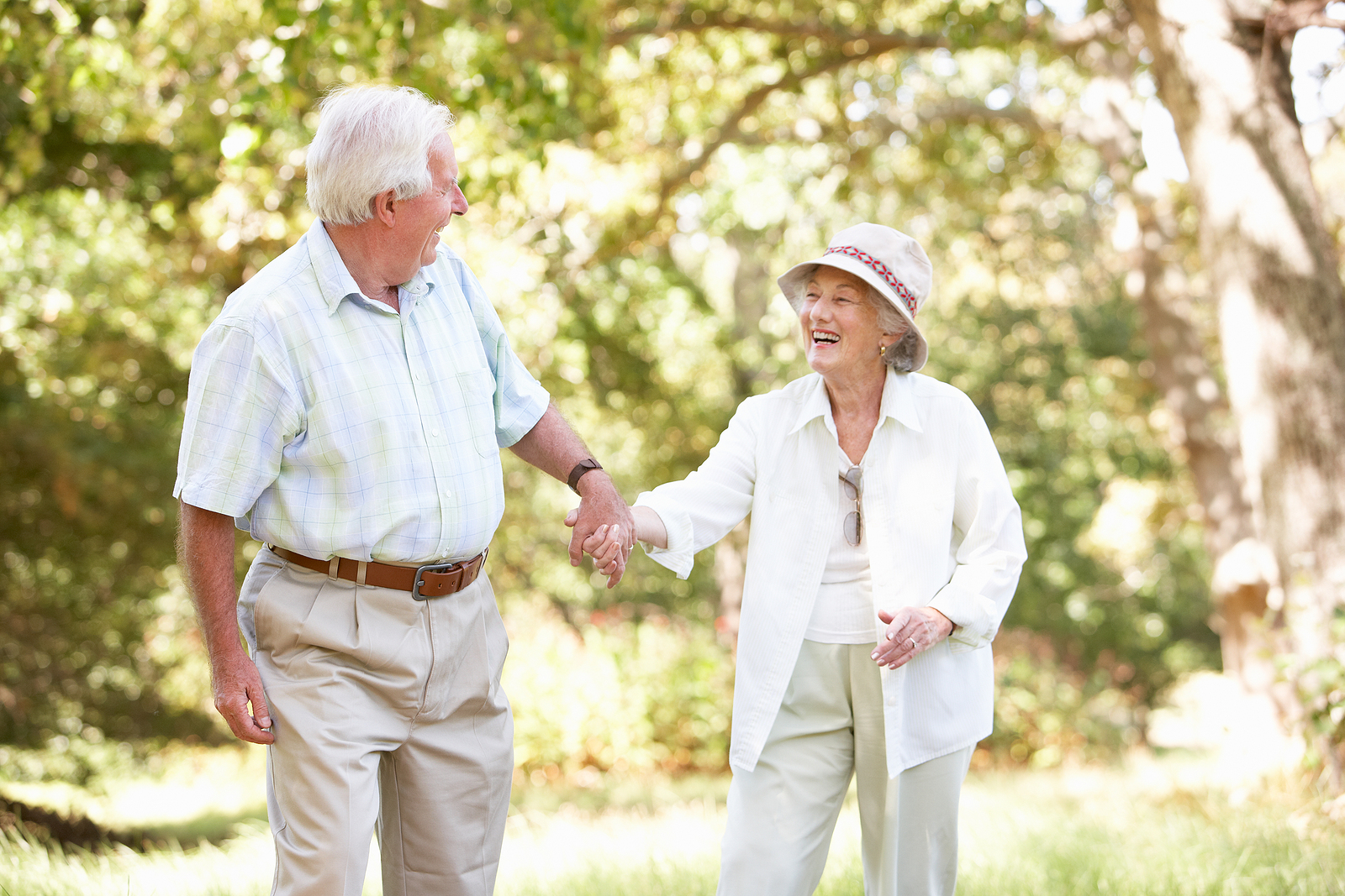 Happy senior couple enjoys time together outdoors