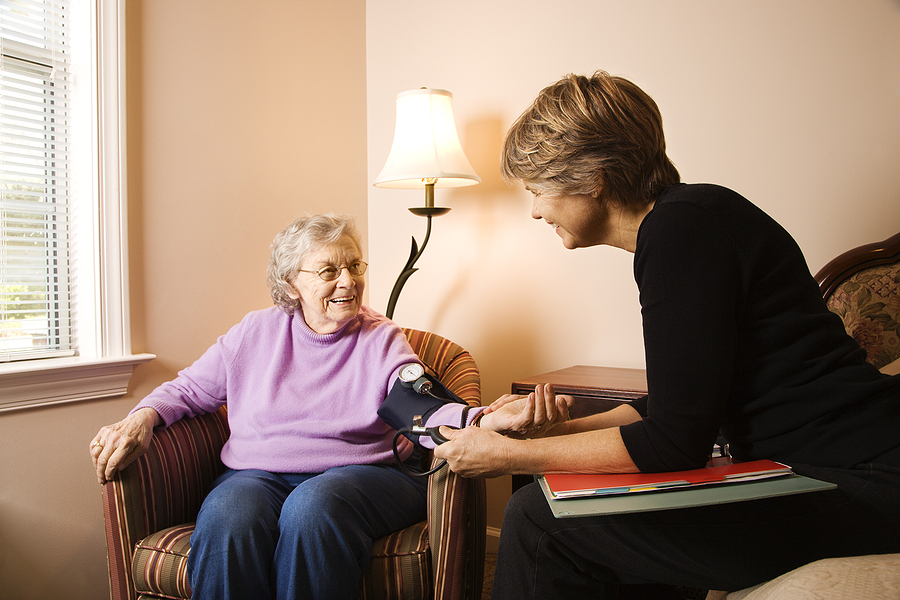 Happy senior woman receives assisted living services from a caregiver