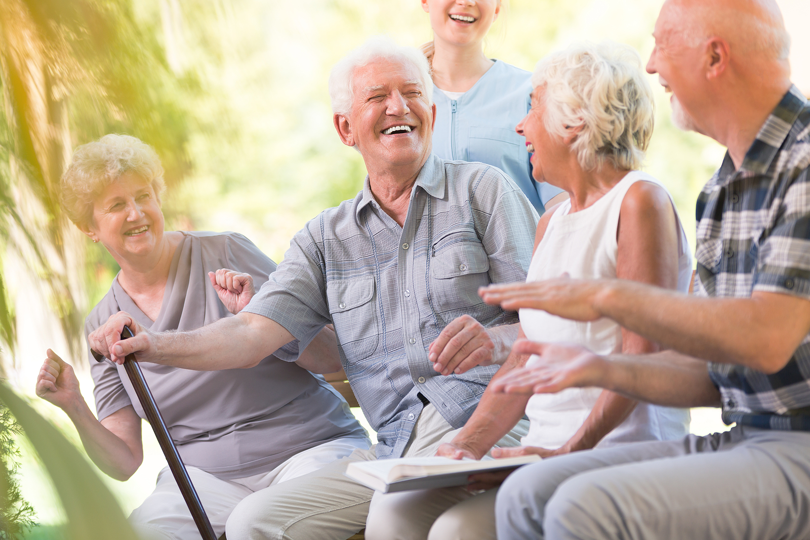Happy group of seniors experience an enhanced lifestyle as a benefit of life plan communities