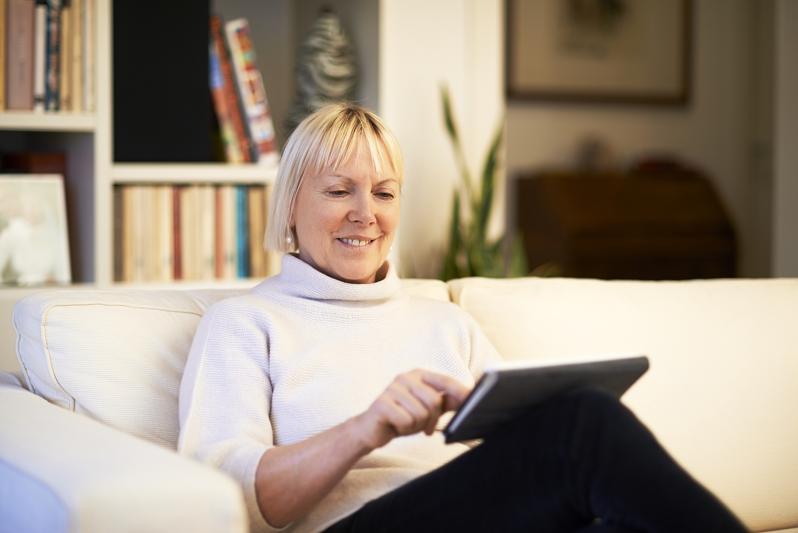 Senior woman uses home care technology to check in with her loved ones