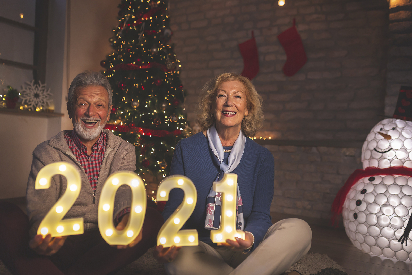 Happy senior couple prepare for 2021 by making new year resolutions
