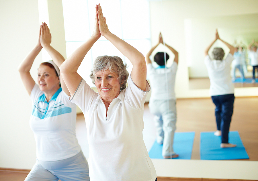 Two women enjoying the benefits of yoga for older adults