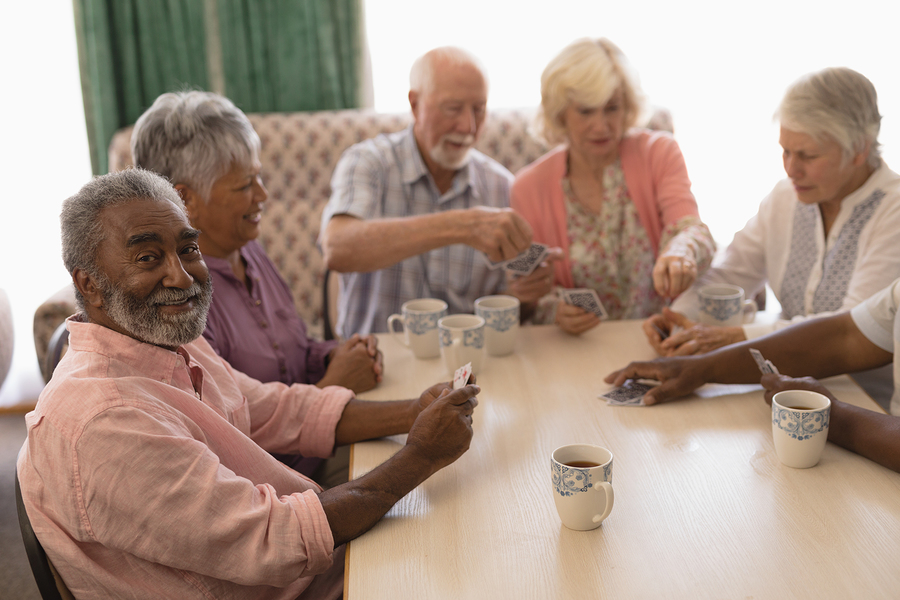 Senior residents enjoying a social card game